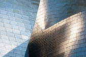 Titanium facade of Guggenheim Museum on June 12, 2013 in Bilbao, Spain. Modern art museum, it was designed by Frank Gehry. — Stock Photo