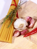 Uncooked Spaghetti and ingredients — Stock Photo