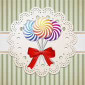 Lollipops and a bow — Vector de stock