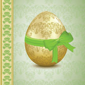 Golden Easter egg width a green bow — Stock Vector