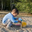 Boy play in the sand — Stock Photo