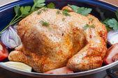 Raw chicken in pot — Stock Photo