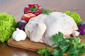 Raw chicken on table — Stock Photo