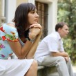 Young woman and man sitting on marble steps in park, selective focus — Stock Photo #14507457