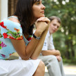 Young woman and man sitting on marble steps in park, selective focus - Stock Photo