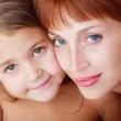 Close-up portrait of beautiful red-haired mother and cute daughter — Stock Photo #14507839