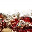 Royalty-Free Stock Photo: Still-life with plenty of colorful Christmas decorations, tree adornments and candleholders on white background with copy space above