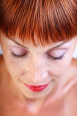 Close-up portrait of red-haired woman, focus on hair — Stock Photo