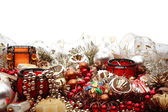 Still-life with plenty of colorful Christmas decorations, tree adornments and candleholders on white background with copy space above — Stock Photo