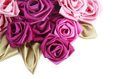 Vinous and pink handmade silk roses on white background with copy space below — Stock Photo