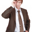 Stock Photo: Young stylish man in brown suit setting right his glasses