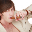 Handsome young man in elegant beige suit smoking cigar — Stock Photo