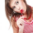 Pretty young girl with trendy makeup sucking red lollipop — Stock Photo #14578863