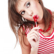 Pretty young girl with trendy makeup sucking red lollipop — Stock Photo