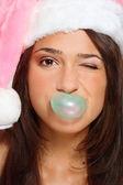 Funny girl in Santa hat — Stock Photo