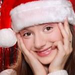 Pretty girl in Santa hat — Stock Photo #14584911