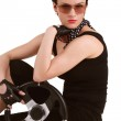 Dark-haired young woman in black gear with steering wheel in her hands — Stock Photo