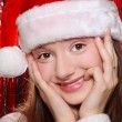 Pretty girl in Santa hat — Stock Photo #14584911
