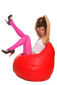 Sexy girl sitting in bean bag — Stock Photo