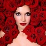 Girl in red roses — Stock Photo #15008577