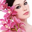 Girl with white orchid — Stock Photo #15261637