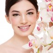 Girl with white orchid — Stock Photo #15263697