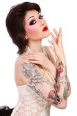 Girl with tattooes — Stock Photo