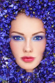 Woman in blue flowers — Stock Photo