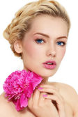 Girl with peony — Stock Photo