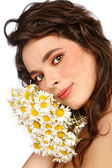 Girl with camomiles — Stock Photo