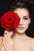 Girl with red rose — Stock Photo