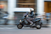 Woman on scooter — Stock Photo