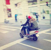 Couple on a scooter — Stock Photo