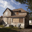Stock Photo: Old Boarded Abandoned House
