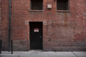 Alley Entrance backside of Brick Building — Stock Photo