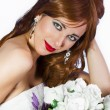 Beautiful red-haired woman with a bouquet of white roses on a wh — Stock Photo