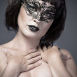 Nude woman, beautiful young in a black mysterious venetian mask — Stock Photo