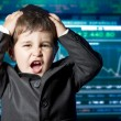 Surprised businessman child in suit with funny face, stock marke - Stock Photo