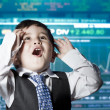 Surprised businessman child in suit with funny face, stock marke — Stock Photo #12599711
