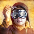 Artistic portrait of child with former flight suit, with hat and — Stock Photo