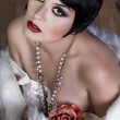 20s style beautiful brunette female wearing fur, exquisite - Stock Photo