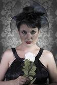 Sad Widow on vintage background, beautiful woman with black veil — Stock Photo