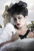 Sad Widow on cemetery background, beautiful woman with black vei — Stock Photo