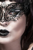 Detail of face of beautiful woman with delicate Venetian mask — Stock Photo