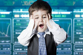 Surprised businessman child in suit with funny face — Stock Photo