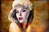 Artistic portrait of woman with fur hat — Stock Photo
