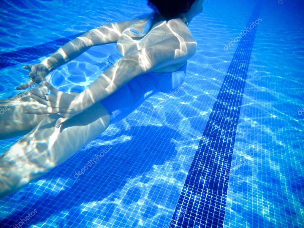 Girl Swimming Underwater In A Swimming Pool Stock Photo Outsiderzone 12599615