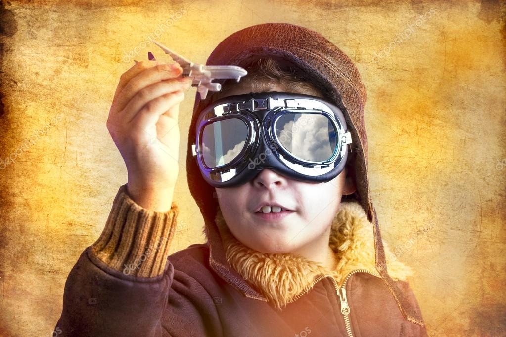 Artistic portrait of child with former flight suit, with hat and sunglasses  Stock Photo #12599741