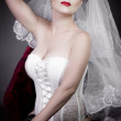 Stock Photo: Beautiful bride with veil and white corset, underwear