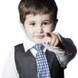 A small boy in the studio, dressed up in a suit and pretending t — Stock Photo